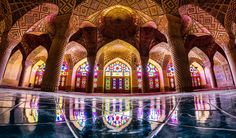Nasir al Molk Mosque in Iran looks quite ordinary on the outside, but the inside is absolutely extraordinary. Each morning as sunlight peeks through a large number of stained glass windows the mosque's interior into a unique life size Kaleidoscope of colors and shapes.