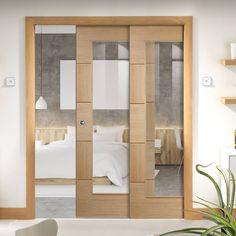 Twin Telescopic Pocket Ravenna Oak Veneer Door - Clear Glass - Prefinished.    #glazeddoors  #moderndoors  #moderninterior  #moderninteriordesign