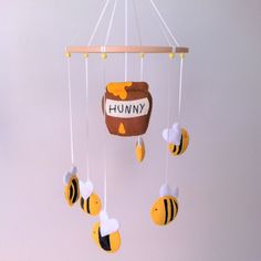 This is a listing for one custom made Winnie the Pooh inspired nursery mobile. What a bright, fun mobile for your baby to gaze at while at the change table or while drifting off to sleep. The perfect mobile for a Winnie the Pooh, yellow or bee themed nursery.  Once payment has been made, this mobile will be hand stitched especially for you. It will take approximately 3-4 weeks.  Each of the six bees are unique with different combinations of wing type, stripes and fabric inlay. Three…