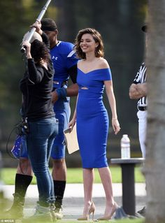 Model figure: Miranda flashed a little of her toned torso with a cut-out portion on her frock