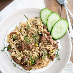 This fragrant Lebanese Lamb Rice dish gets served over a bed of tangy plain yogurt: a combination of flavors that will no doubt please your palate.