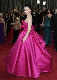 Students of red carpet glamour have certainly become familiar with Fan Bingbing—but everyone else? Get ready to have a new red carpet fave. The 33-year-old Chinese actress long-ago conquered international best-dressed lists (she was on Vanity Fair's tony Best Dressed list in 2012), but now she's poised to get a bit more mainstream—Forbes just handed her the number four spot on its list of the year's highest-paid actresses, reporting that she's net a cool $21 million in 2015. F...