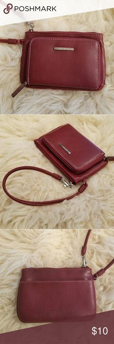 """Nine West Wristlet Wallet faux red leather Never used. Wallet and wristlet in one. Strap is also the zipper pull. Red wine color. All man made materials.  Measurements  (approx): 6"""" wide x 4"""" high Nine West Bags Clutches & Wristlets"""