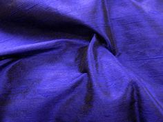 "Thai Silk Dupioni - Sapphire (iridescent dark purple with black). 100% Silk. 44"" wide. Dry clean. Priced per yard. Looks more purple than Sapphire (sapphire is the manufacturers name for the color, not ours.)"
