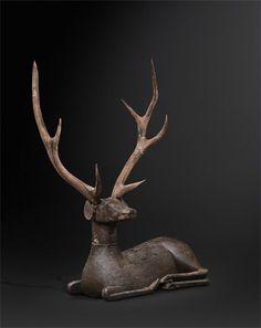 Deer. China, Warring States Period (475-221 BC) Carved wood with traces of polychromy. 27.6 x 22.4 inches (70 x 57 cm). Photo courtesy Jacques Barrère