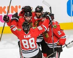 Patrick Sharp #10 of the Chicago Blackhawks celebrates with teammates Michal Rozsival #32, Duncan Keith #2 and Patrick Kane #88 after scoring against the Boston Bruins in the first period in Game Two of the Stanley Cup Final at the United Center http://www.fansedge.com/Celebration-Chicago-Blackhawks-Stanley-Cup-Final-Game-2-6152013-_-1076200682_PD.html?social=pinterest_pfid77-37979