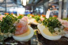 Danish smørrebrød: Slices of buttered brown bread topped with egg, shrimp and mayonnaise. Torvehallerne, Copenhagen.