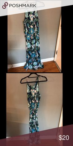 Floral Print Maxi Dress Ann Taylor Loft Floral print maxi dress. Never worn. Straight through hips, cinches in the middle. LOFT Dresses Maxi