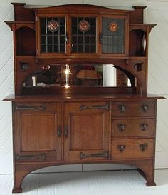 Arts & Crafts oak sideboard with 3 leaded glass panels incorporating stylised copper roundels and cut out decoration. Craftsman Furniture, Rustic Furniture, Antique Furniture, Home Furniture, Furniture Design, Outdoor Furniture, Modern Furniture, Furniture Stores, Furniture Outlet
