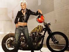 """musical artist """"Pink"""" posing with a motorcycle"""