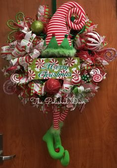 XL Christmas wreath with an Elf dressed in red white striped leggings and green boots.  He's a handsome fellow who will make a statement on your door.  Matching Christmas ribbons and premium deco mesh with ornaments and swirl picks to compliment.  Use code localpickup for free shipping if delivery address is within Galveston County, Texas,USA. | Shop this product here: http://spreesy.com/thepolisheddoor/83 | Shop all of our products at http://spreesy.com/thepolisheddoor    | Pinterest…