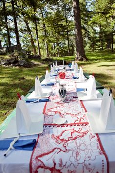 A preppy nautical themed party- Maps printed as the table runner.
