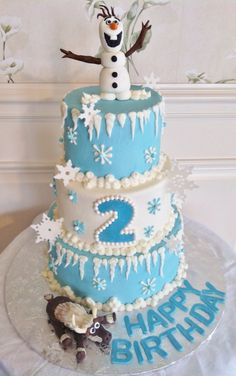 Disney's Frozen themed cake - buttercream iced tiers with modeling chocolate snowman and moose