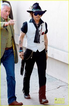 Johnny On his own style planet Great actor, quirky dresser :-)
