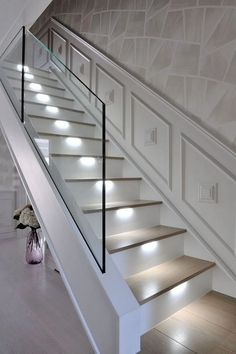 An ultra-modern staircase in light oak with LED lights installed under the steps, subtly illuminate the stairs. An ultra-modern staircase in light oak with LED lights installed under . beleuchtung beleuchtungkro moderne Beleuchtung An ultra-moder Glass Stairs Design, Home Stairs Design, Railing Design, Interior Stairs, House Design, Glass Stair Railing, Stairs With Glass Panels, Modern Stairs Design, Glass Bannister