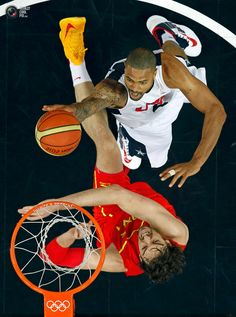 Day 16 - Chandler of the U.S. goes in for a dunk over Spain's Gasol during their men's gold medal basketball match at the North Greenwich Arena in London during the London 2012 Olympic Games . MIKE SEGAR/REUTERS