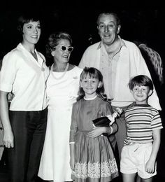 "Walt and Lillian Disney visit with Julie Andrews and her ""charges"" during production of ""Mary Poppins."""