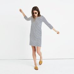 A stretchy, stripy dress with a low-key nautical feel (check out that button detail). Try it with sandals now, boots later—this navy and cream style is a true year-rounder.  <ul><li>Nonwaisted.</li><li>Cotton.</li><li>Machine wash.</li><li>Import.</li></ul>
