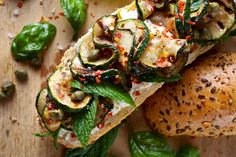 Sandwich with grilled zucchini, goat cheese and capers
