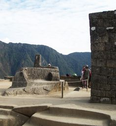 """The famed """"Intihuatana Stone"""" at The Site.  Ledgend had it that if you touched the stone--it revealed your true life's purpose.  Does it work?  You'll just have to go and see for yourself!!!   Peru, Machu Picchu"""
