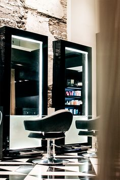 The decor of this modern elegant beauty salon creates a sense of luxury through the use of black and white tile patterns.  The interior design is sophisticated with its use of bronze sheer curtains to create private treatment rooms. Other decor ideas are the use of sleek styling stations giving a boutique hair salon ambience. | #chair | #stylingstation | #hair |
