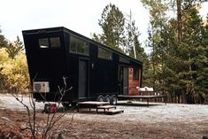 Developed by Land Ark RV, Draper is a tiny house on wheels of clad in jet black, corrugated steel siding and renewable Brazilian hardwood. Bungalow, Brazilian Hardwood, Steel Siding, Loft Plan, Temporary Housing, Clerestory Windows, Tiny Cabins, Sliding Patio Doors, Sleeping Loft