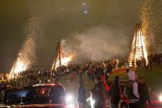 Spectators enjoy the bonfires along the Mississippi River levee in Gramercy Friday, December 24, 2014. For generations, residents of St. James Parish have welcomed Christmas Eve with bonfires. Visitors strolled along the levee top enjoying the unique holiday tradition. (Photo...