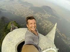 Lee Thompson takes epic selfie from inside the head of Christ the Redeemer above Rio de Janeiro.