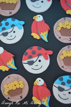 - Fondant pirate themed cupcake toppers. Arrrrrgh! On cake central by musicmommy1