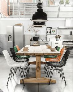 wood table + mismatched chairs + black oversized lighting