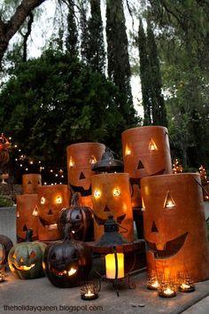 Home Depot Pottery Pumpkin Luminaries assembled to create a garden divider. Fete Halloween, Halloween Lanterns, Outdoor Halloween, Halloween Projects, Holidays Halloween, Spooky Halloween, Vintage Halloween, Halloween Pumpkins, Halloween Decorations