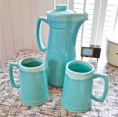 Vintage Hull Turquoise Pottery White Drip Coffee Pot with Mugs 1960's RARE. Those coffee mugs look like beer steins - they must have been serious coffee drinkers back then.