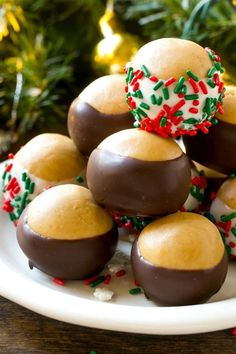 This recipe for buckeye balls is classic peanut butter balls dipped in dark or white chocolate and coated with sprinkles. An easy no bake holiday dessert! Rich and creamy peanut butter balls are dipped in Easy Christmas Treats, Easy Christmas Cookie Recipes, Christmas Sugar Cookies, Christmas Cooking, Holiday Cookies, Holiday Baking, Christmas Desserts, Holiday Recipes, Christmas Candy