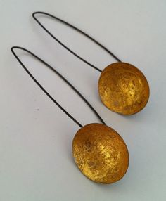 Heidi Abrahamson Earrings, oxidized sterling and 23kt gold concave discs.