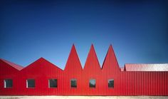 Red painted sheet metal facade.