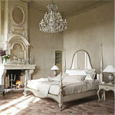 Vaulted Ceiling + Crystal Chandelier + Stone Fireplace = Stately Bedroom
