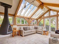 Stainless Steel Tie Rod and Oak Truss in Contemporary Oak Framed Extension on Farmhouse in Devon by Carpenter Oak Ltd