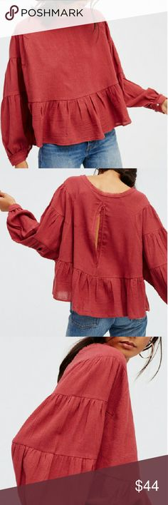 NWT Free People Wildcat Top NWT Free People Wildcat Top  Oversized and gauzy blouse with a cute peplum silhouette, unfinished edges around the neckline and sleeve cuffs for a lived-in look. Made from 100% vintage cotton in Deep Rose.   Brand NWT ~ no flaws     AVE an extra 20% with a bundle discount    Ships next business day  Free People Tops Blouses