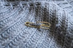 Haute safety pin jewelry made in Brooklyn - show your vulnerable sisters that you will protect them!
