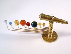 Miniature Medieval Movable Orrery and Telescope Ooak Dollhouse Mini You Can Move The Planets. $45.00, via Etsy.