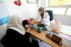 Credit: Graeme Robertson/IPPF A woman is given advice on contraception at the PFPPA office in Hebron