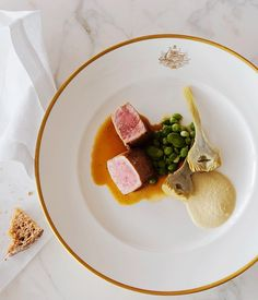 This barbecued veal dish is elevated to sophistication with a simple oyster cream and hearty braised artichokes.