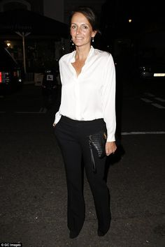 City chic:Saffron Aldridge rocked a plunging white blouse with black trousers...