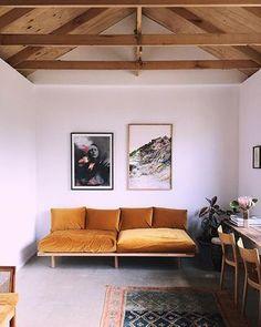 Burnt orange gold modern sofa, large scale art prints