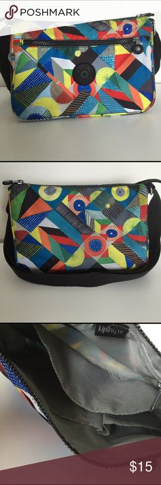 """Colorful Kipling Bag Lightweight and brightly colored Kipling cross body bag. Some wear shown in last picture. No holes, rips or tears. All zippers work. Bag is in good usable condition. Height 8"""", length 10.5"""", width 4"""". Shoulder strap is 51"""" when fully extended. Kipling Bags Crossbody Bags"""