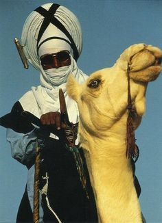 Touareg man on his camel, Algeria, North Africa. The Algerian Culture.