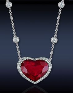 Heart Ruby Pendant, Featuring: CDC Certified Ct Intense Red, Heart Shape Natural Thai Ruby Stone), Surrounded by Ct Pave' Set Round Brilliant Cut Diamonds Stones), Mounted in Platinum. Red Jewelry, Heart Jewelry, Fine Jewelry, Women Jewelry, Jewellery, Ruby Pendant, Diamond Pendant Necklace, Diamond Jewelry, Pendant Jewelry