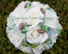Handmade Seattle Seahawks 12th Man NFL Football team inspired bridal bouquet by Sunshine Petals Boutique!  Other teams available include Ravens, Bills, Bengals, Browns, Broncos, Texans, Colts, Jaguars, Chiefs, Dolphins, Patriots, Jets, Raiders, Steelers, Chargers, Titans, Cardinals, Falcons, Panthers, Bears, Cowboys, Lions, Packers, Vikings, Saints,Giants, Eagles,Rams,49ers, Seahawks, Buccaneers,Redskins.  Sunshine Petals Boutique.  Owner, Rhonda Newton - 208.262.6148
