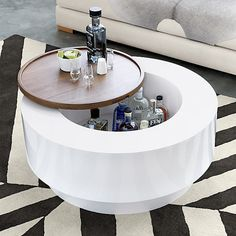 A coffee table that doubles as a bar... yes.