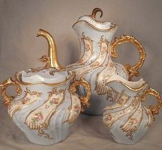 French Sevres Blue Limoges Handpainted Porcelain Teaset Swirled Swirl Description: Now up fo rauction is this antique Sevres French porcelain Teaset. It includes Teapot Creamer and Sugar Bowl. It has